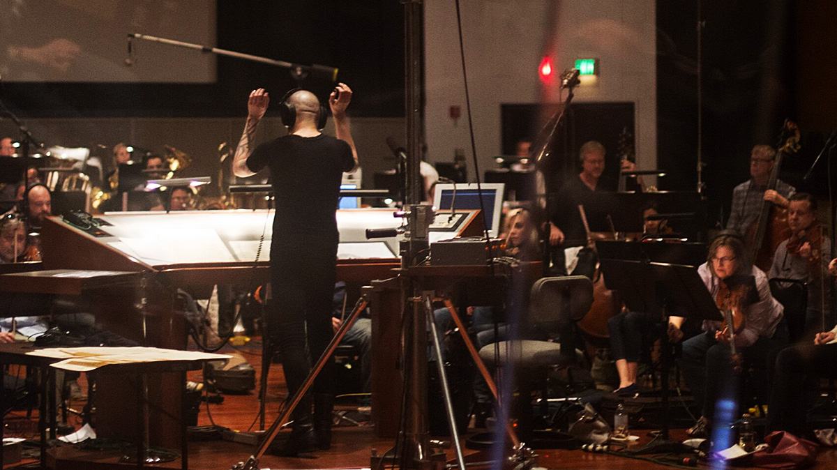 Joseph Bishara recording horror movie music with a studio orchestra